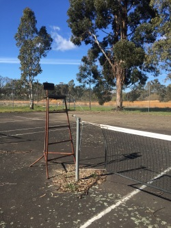 With the decline in interest in some sporting clubs these courts are deteriorating. Have to love the old umpires stand.